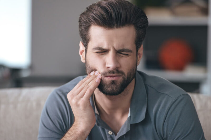 Frustrated young man with toothache