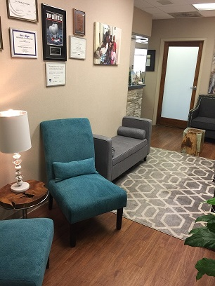 Office indoor with paintings on wall and chair